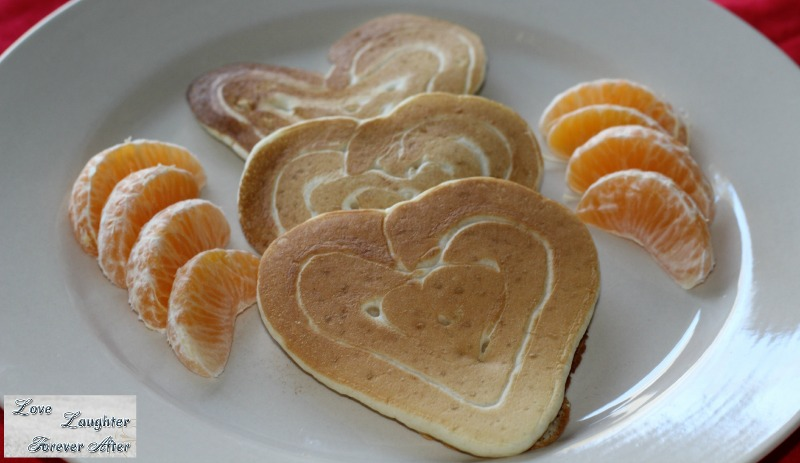 Valentine's Day Treats Ideas heart shaped pancakes served with orange slices