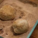 roll balls of dough in cinnamon and sugar